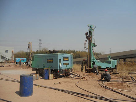 water well drilling rig at worksite