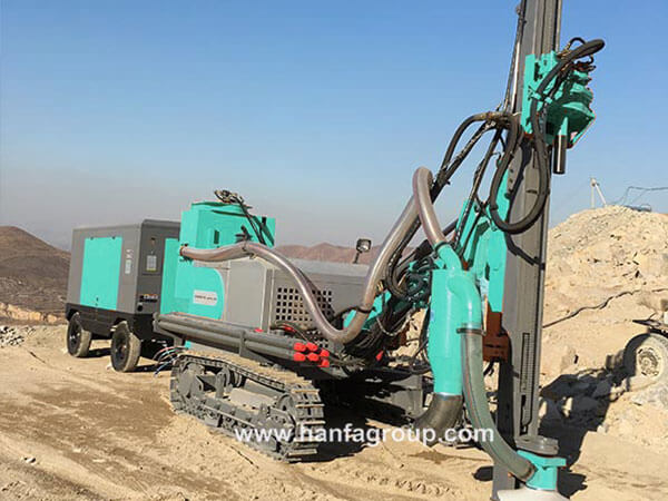 Integrated DTH drilling rig
